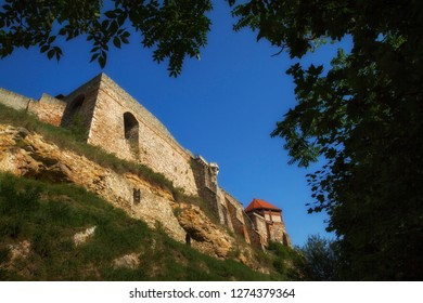 Scenic view of ruin royal castle, roofs and towers in Watertown (old town under castle) in Esztergom, Hungary at sunny day.