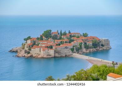 Scenic view of Saint Stephen (Sveti Stefan) island in Adriatic sea connected with coast by bridge. Beautiful aerial photo of luxury resort on Adriatic sea.