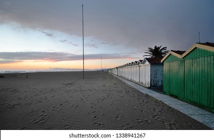 scenic view of the sandy beach in Versilia coastline during winter sunset