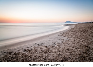 Scenic View Of Sea Against Sky At Morning in Oliva, Valencia, Spain. Long exposure shot, blurred motion