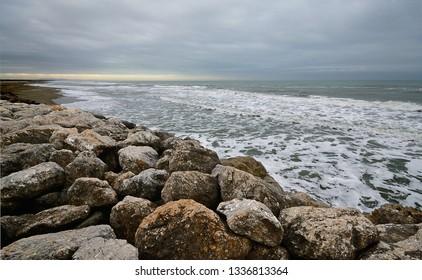 scenic view of a sea storm in the Versilia tuscan coastline on a winter day