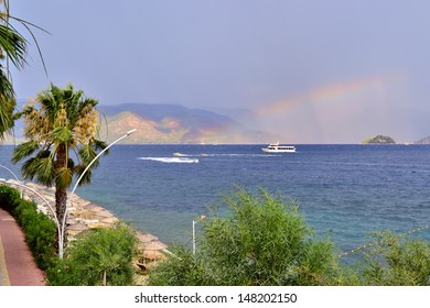 scenic view of sea, stormy sky, rainbow and mountains near Marmaris