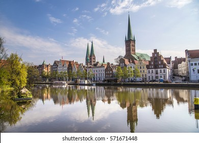 scenic view to skyline of Luebeck at river Trave