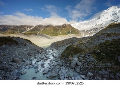 Scenic view of snowcapped Southern Alps mountains and Mueller Lake at Hooker Valley, Aoraki/Mount Cook National Park, South Island of New Zealand.Tourist popular hiking attraction/destination.