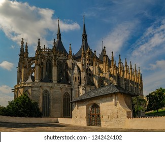 Scenic view of St Barbara Church under blue sky with picturesque clouds, Kutna Hora, Czech Republic. UNESCO World Heritage site