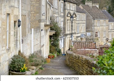 Scenic View of a Stone Pathway Running past Old Terraced Cottage Houses in a Typical English Town - Namely the Picturesque Town of Bradford on Avon in Wiltshire England