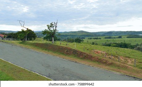 Scenic view of a street by a farm with a view of the hills in the horizon - Campinas, SP/Brazil