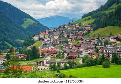 Scenic view of the streets in alpine village in the green valley among the mountain hills, St Christina, Dolomites, South Tyrol, Italy