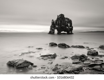 Scenic view of a striking rock formation in shallow water on a beach with stones - Location: Iceland, east coast of the Vatnsnes peninsula in the northwest, Hvítserkur
