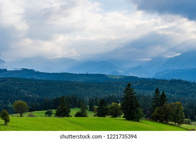 Scenic view of sun rays over mountain landscape. Beautiful summer landscape in High Tatras mountains. Sun rays over hills and valley.