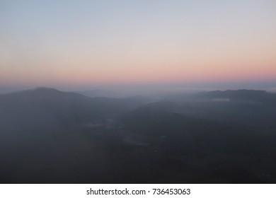 Scenic view of sunrise with misty sky in Tinker Cliffs hike, Appalachian Trail, Catawba, near Virginia Tech, Blacksburg