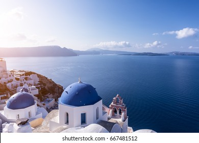 Scenic view of sunset over blue domes in Oia village, Santorini island, Greece