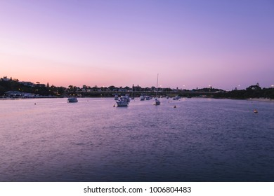 Scenic view of swan river with boats and yachts before sunrise, stirling bridge in the background.