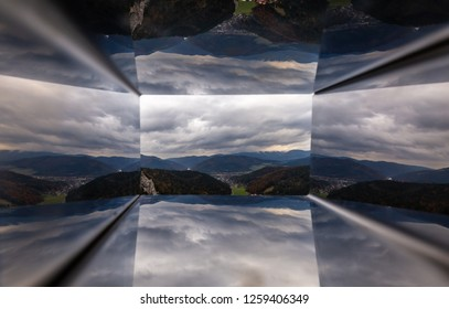 Scenic view through Wiener Alpen Viewer miror hole from top of Hausstein to green valley of Muggendorf with colorful autumn forest