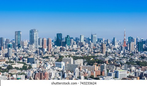 Scenic view of Tokyo Metropolis with many skyscrapers under the blue sky. Tokyo is the capital of Japan.