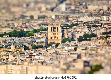 Scenic view from the top of the Eiffel Tower on Notre Dame. Paris, France. Miniature tilt shift lens effect.