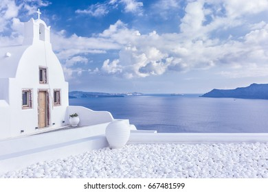 Scenic view of traditional greek church in Oia village, Santorini island, Greece
