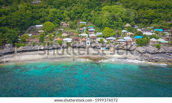 Scenic view and Traditional hut at Lamalera, Nusa Tenggara, Indonesia. Lamalera is home of the Traditional Whale Hunting people
