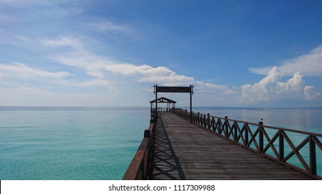 Scenic view of a turquoise ocean from an old wooden dock  Text in photo: Thank you... If you liked it here, please come again soon.