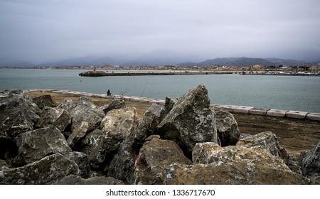 scenic view of the Viareggio port entrance, in Versilia coastline, on a winter grey day