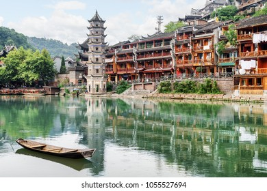 Scenic view of the Wanming Pagoda reflected in water of the Tuojiang River (Tuo Jiang River) in Phoenix Ancient Town (Fenghuang County), China. Fenghuang is a popular tourist destination of Asia.