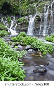 Scenic view of waterfall in tropical jungle, Reunion Island.