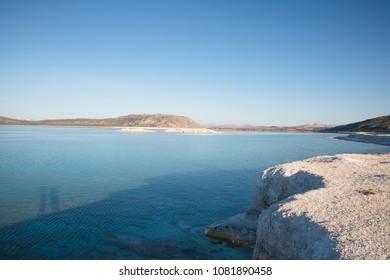 scenic view of white limestone on shore of beautiful calm lake, salda golu, turkey