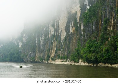 Scenic view of wild tropical jungleand speed boat on the Mahakam river, East Kalimantan, Indonesia Borneo.