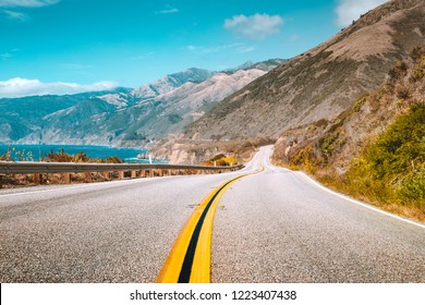 Scenic view of world famous Highway 1 with the rugged coastline of Big Sur in beautiful golden evening light at sunset in summer, California Central Coast, USA