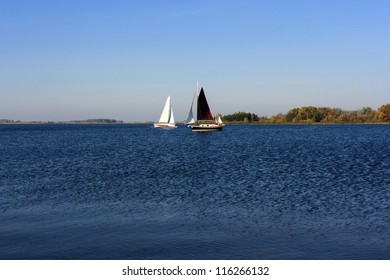 Scenic view of yacht sailing on lake, viewed from beach. Lithuania