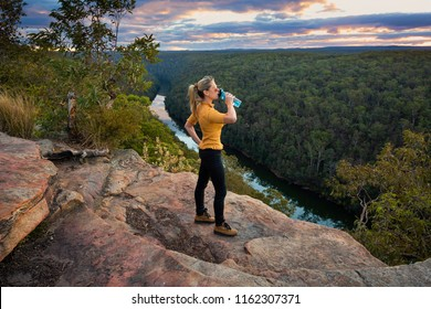 Scenic views bushwalking through Blue Mountains Australia arriving at a  rocky outcrop with views over the mountain ridge and river gorge