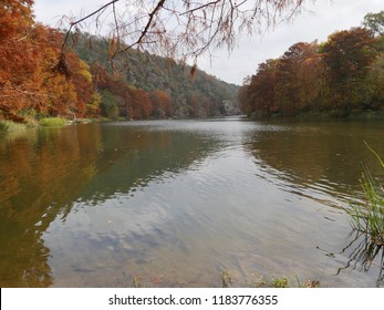 Scenic views of the Mountain Forks River at the Beavers Bend State Parks in Broken Bow, Oklahoma with colorful foliage in autumn