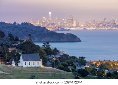 Scenic views of Old St Hillary's Church, Angle Island, Alcatraz Prison, San Francisco Bay and San Francisco Skyline at dusk. Shot from Tiburon, Marin County, California, USA.