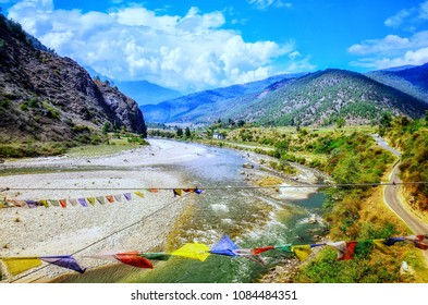 The scenic views of the Punakha valley , Pho Chhu river and surrounding mountains.