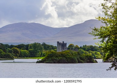 scenic views of Ross Castle while enjoying an Irish traditional Horse and Jaunting car ride around Lake Killarney and park area