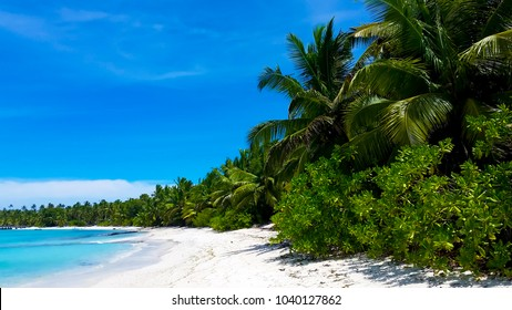 Scenic views of the tiny Cocos (Keeling) Islands a remote territory of Australia in the Indian Ocean with 2 coral atolls comprising 27 tiny islands with white­-sand beaches, palm trees and lagoons.