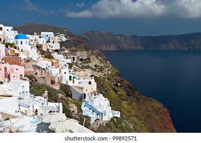 Scenic village of Oia and the volcanic caldera of Santorini island  in Cyclades, Greece