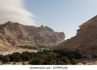 A scenic wadi in the eastern region of the Dhofar mountains during a road trip through Oman