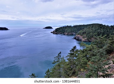 Scenic Water Ocean view of Deception Pass in State Park Oak Harbor Washington Islands Trees and sky in background