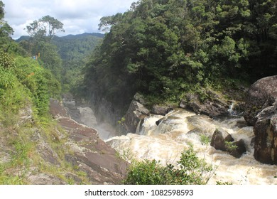 Scenic waterfall with a rainbow on Ranomafana river in Ranomafana National Park, Madagascar