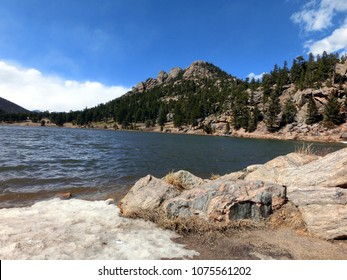 Scenic wilderness lake with snowy shore