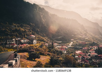 Scenic winding road across mountain villages at sunset on Madeira island, Portugal