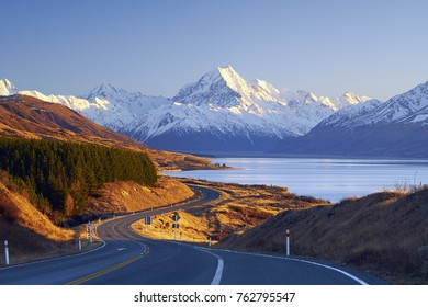 Scenic winding road along Lake Pukaki to Mount Cook National Park, South Island, New Zealand during cold and windy winter morning. Most beautiful view of Mount Cook.