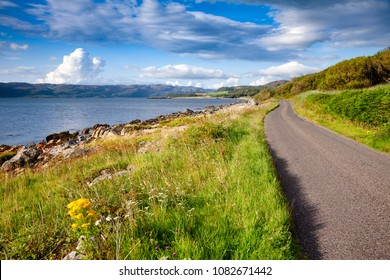 Scenic winding road along the sea Loch Caolisport at Kintyre peninsula, Argyll and Bute, Scotland, UK