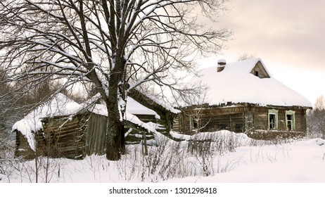 Scenic winter landscape with old hut