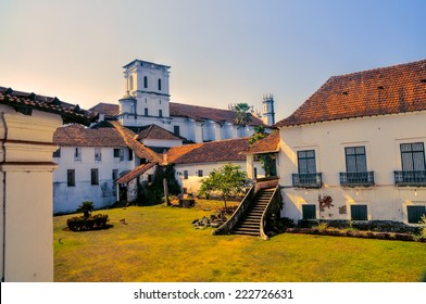 Scenic yard and old houses in historical town of Old Goa in India