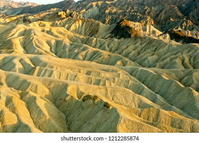 Scenic Zabriske Point in Death Valley National Park at sunset.