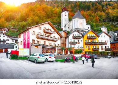 Scenicview of famous Hallstatt mountain village with Hallstatter lake.Typical Austrian Alpine houses with bright flowers. Location: resort village Hallstatt, Salzkammergut region, Austria, Alps.