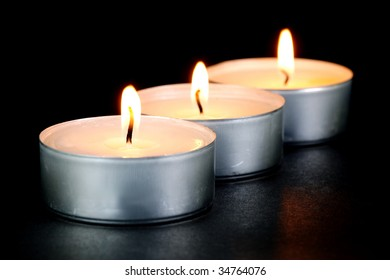 Scented candals isolated against a black background