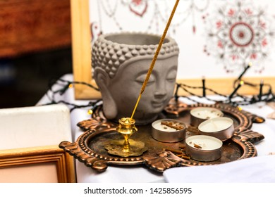 Scented incense and buddha head